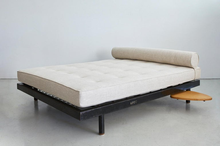 Rare and stunning S.C.A.L. Antony double daybed with pivoting oak side tables designed by Jean Prouvé and Charlotte Perriand. Newly upholstered in slubby greige linen. Manufactured by Ateliers Prouvé, France, circa 1951.