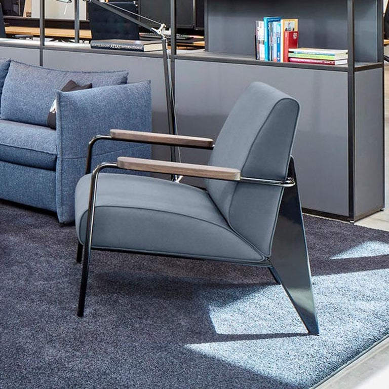 Armchair designed by Jean Prouvé in 1939. Manufactured by Vitra, Switzerland.  Developed by Jean Prouvé, the Fauteuil de Salon is a typical example of the distinctive structural aesthetic of his designs. The armchair's understated character suits