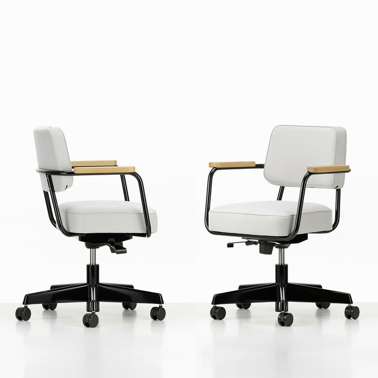 Chair designed by Jean Prouvé in 1951. Manufactured by Vitra, Switzerland.  The swivel seat of Fauteuil Direction Pivotant is height adjustable, and the backward tilt mechanism can be adapted to the individual user's weight. These features are