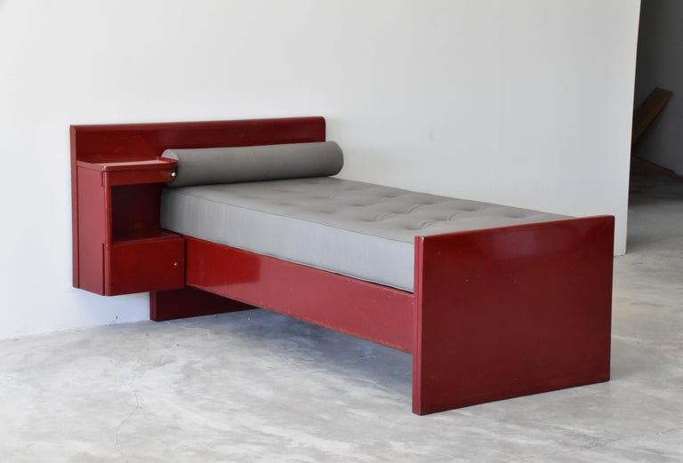 An early functionalist daybed designed by Jean Prouvé & Jules Leleu, from their iconic commission for Sanatorium Martel de Janville, Plateau d'Assy, France The daybed features a built-in side cabinet.   Secondary cushions upholstered in dyed in