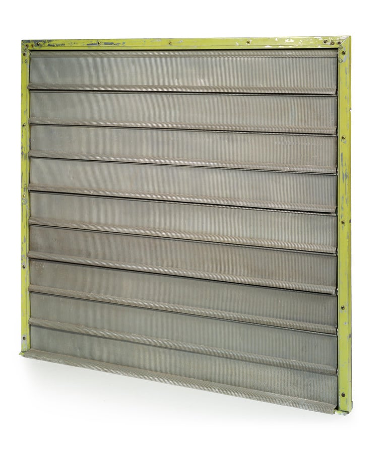 Jean Prouvé  Louvers, 1952.  Provenance - One of 19 ground level studios from The Unité d'habitation Air France, Brazzaville –Congo.  Nine adjustable louvers, gray lacquered, in folded grooved aluminum sheet, connected by a rail system