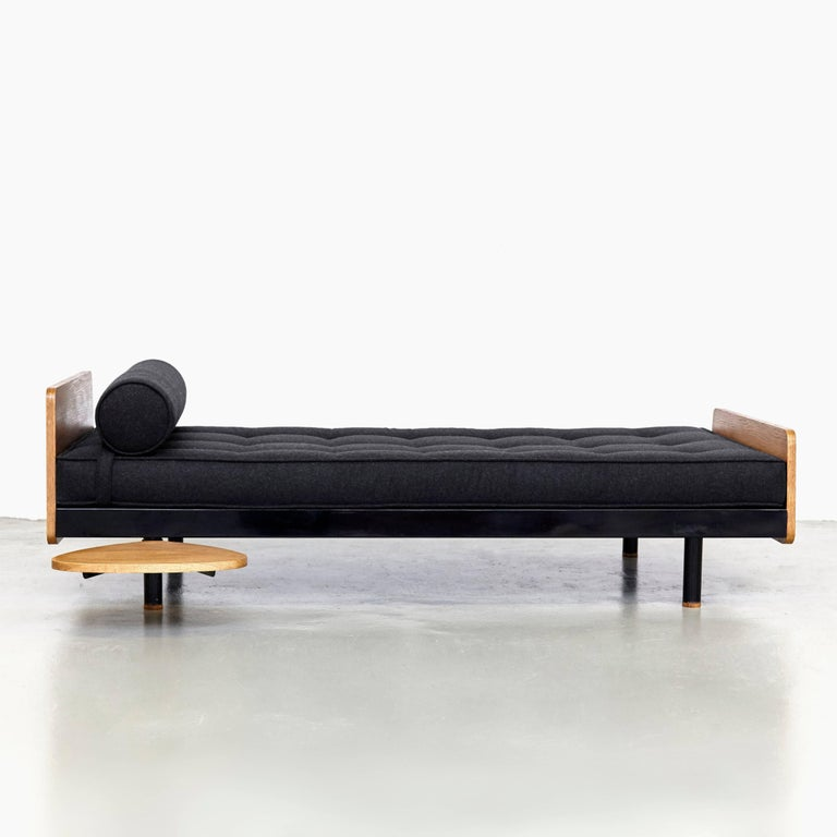 S.C.A.L. daybed designed by Jean Prouve. Manufactured by Ateliers Prouve, France, circa 1950. This bed has been restored. Metal frame, wood, new upholstery.  In good condition, with minor wear consistent with age and use, preserving a beautiful