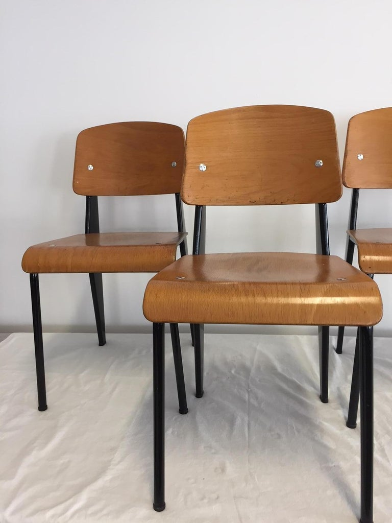'Semi-Metal' No. 305 chairs by Jean Prouve, and manufactured by Ateliers Jean Prouvé, France, circa 1950. Enameled steel color black and beech plywood. Provenance Galerie DownTown / Francois Laffanour.