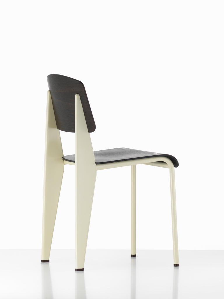 Jean Prouvé Standard chair in dark oak and white metal for Vitra. The Standard chair is an early masterpiece by the French designer and engineer Jean Prouvé. Originally designed in 1934, the Standard evolved into one of the most famous classics of