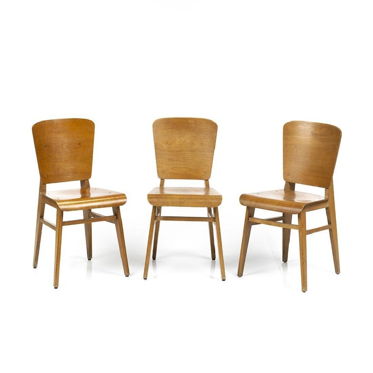 Set of six molded birch plywood dining chairs in the style of Jean Prouvé, France, circa 1950s.