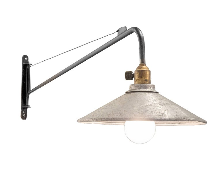 There are few designs from the midcentury that define the simplicity and functionality of Prove's classic wall light. The shade is not documented as being from Alteliers Jean Prouve but it is of the period and works splendidly with the wall light.