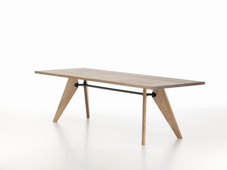 Table designed by Jean Prouvé in 1941. Manufactured by Vitra, Switzerland.  Jean Prouvé developed Table Solvay during the Second World War and due to the scarcity of metal at that time, he designed the elegant piece with wooden legs.  During