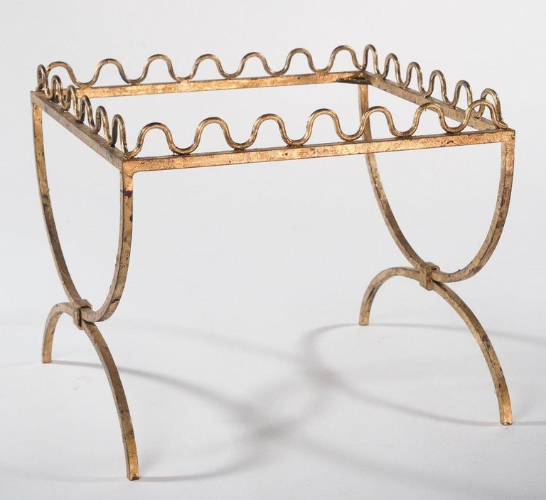 French midcentury small drinks table or bench (can take thick glass inset top or upholstered drop-in seat) in the style of Jean Royère. Gold-leafed forged iron.