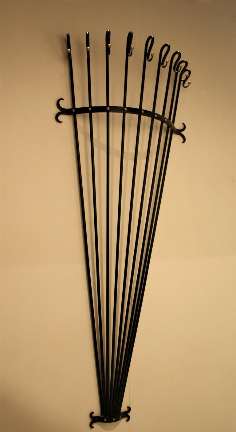 Very special and rare wrought iron wall coat rack in the style of Jean Royère. A very decorative design with beautiful accents and a perfect size. This coat rack is very easy to attach with four screws, the whole is very sturdy and traditionally