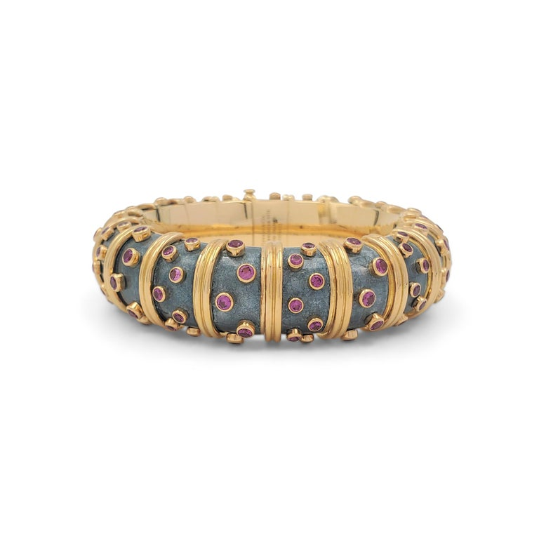 An iconic 'Jackie' bracelet designed by Jean Schlumberger for Tiffany & Co. The articulated link bombe bracelet is crafted in 18 karat yellow gold and features a rare color combination of slate gray paillonné enamel which is accented by raised round