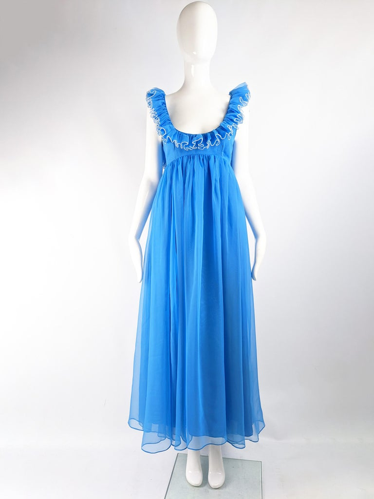 A beautiful vintage full length Jean Varon evening gown from the 60s, in a floaty blue chiffon with white edging and a fabulous ruffled collar and deep open back.  Size: Unlabelled; fits like a UK 10/ US 6/ EU 38. Please check measurements.  Bust -