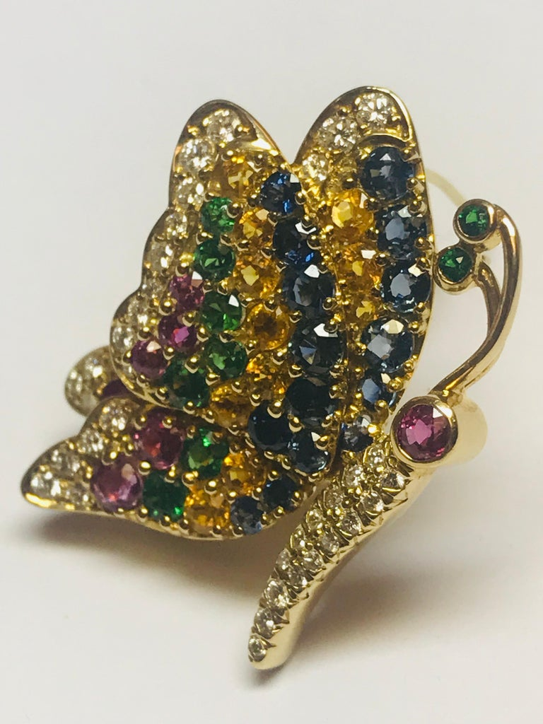 The combination of these 5 stones is perfectly designed, and created, by Jean Vitau to enhance the beauty of this profile butterfly pin. The multi colored piece has .67 carats of Diamonds, 1.80 carats of Blue Sapphires, 1.10 carats of Yellow