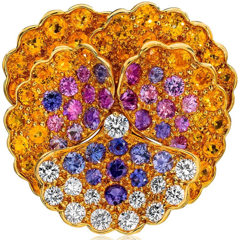 Designed by the famed French designer Jean Vitau for Gemveto.  Jean Vitau was a pioneer jewelry designer . He was known for patenting the Gemlok setting ,a secure and snag proof way of setting diamonds and colored stones.  This lovely pansy brooch