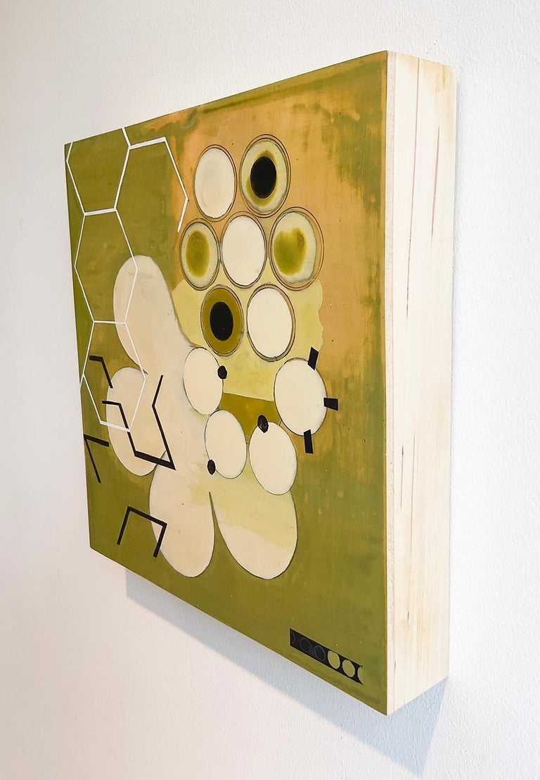 Contemporary abstract geometric painting on 12 x 12 inch wood panel with circles of white and yellow with octagonal shapes throughout the space. Green Mother #1, 2020, by Jeanette Fintz 12 x 12 x 2 inches, acrylic on wood panel Signed verso  D-rings