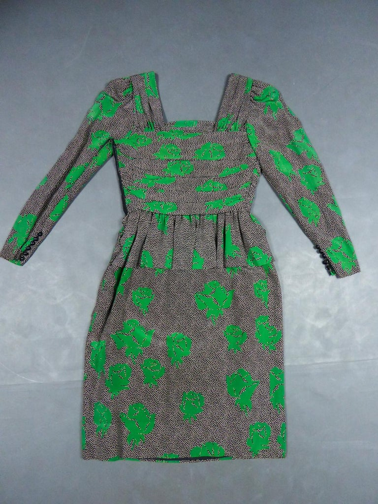 Circa 1980 France Paris  Jeanne Lanvin Haute Couture mid-length dress in printed silk by Jules-François Grahay who directed the designer houseuntil 1984. Black silk crepe printed with white dots and stylized green roses arranged randomly. Dress