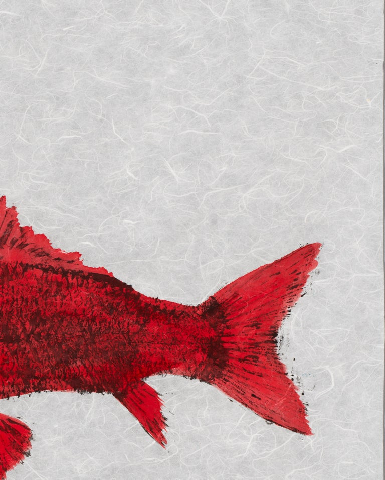 This is a Gyotaku method painting of two fish on a pale blue mulberry paper background.  This double fish impression using minimal color is akin to a fossil.  The fish are hand painted in Red and Blue.  The mulberry paper has a soft hue and slightly