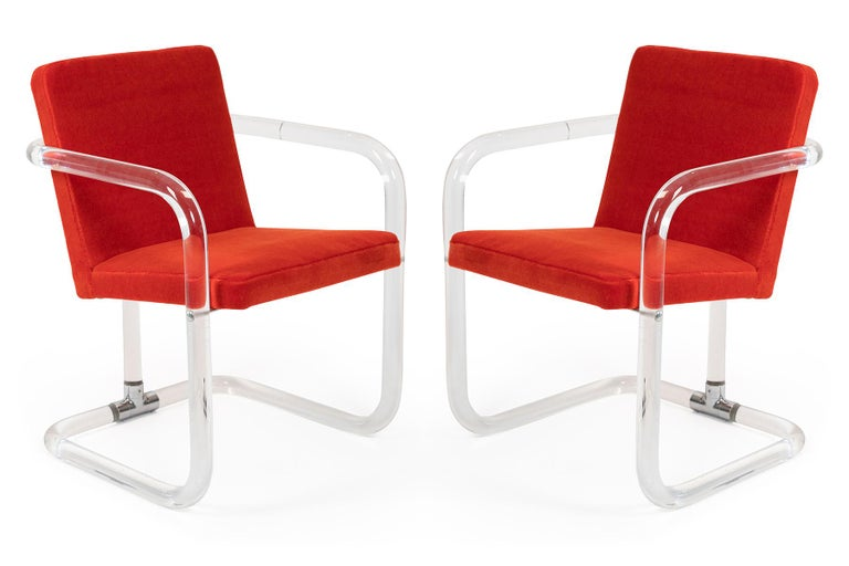 Pair of tubular lucite chairs by Jeff Messerschmidt, circa early 1970s. These examples have been newly upholstered in mohair. Price listed is for the pair.