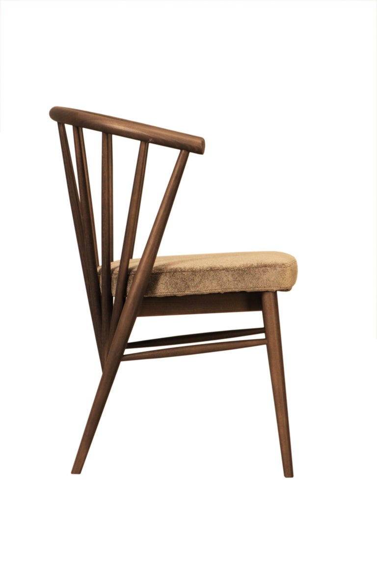 Jenny is an upholstered chair made of hand-turned ashwood. The curved backrest is made of a raw of ash poles fixed at different angles. Customizable with different wood finishes and coating materials and colors Made in Italy by Morelato