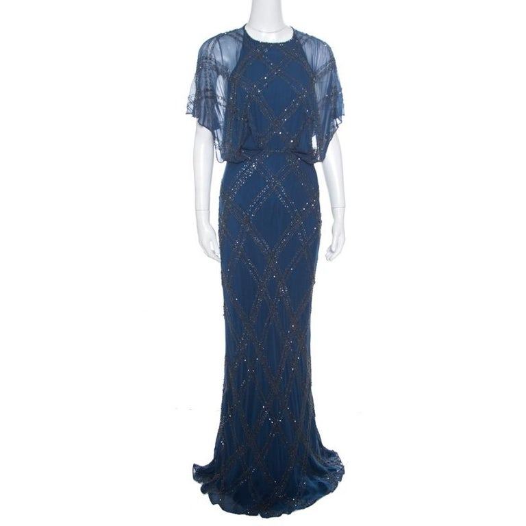 Beautifully embellished with crystals and beads creating an elegant embroidery all over, this breathtaking gown from Jenny Packham is ideal for special events. The floor-grazing length and gorgeous blue color combine to make it as sophisticated as