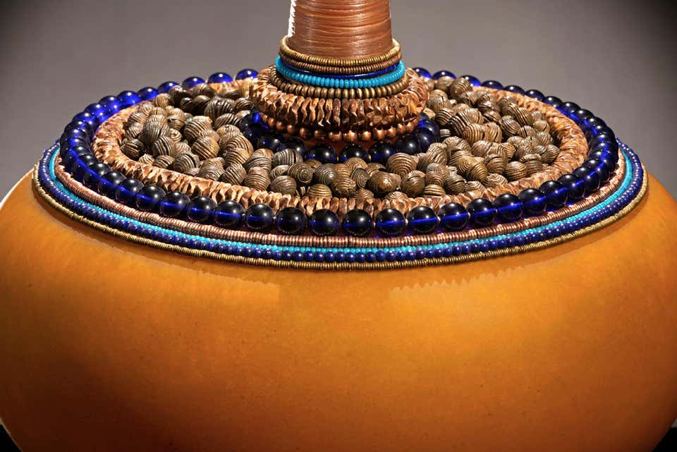 https://a.1stdibscdn.com/jenny-pohlman-and-sabrina-knowles-sculptures-mekong-meditation-sankofa-series-blown-sculpted-sandblasted-glass-beads-for-sale-picture-3/a_972/a_47775821564504627933/Mekong_Meditation_bead_detail_master.jpg?disable=upscale&auto=webp&quality=60&width=960