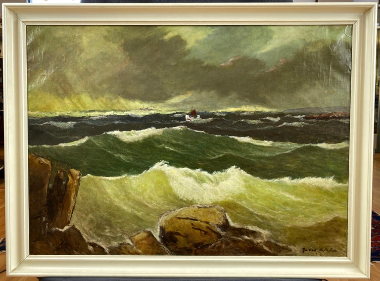 A 1953 oil painting of a stormy coastal sea by Jens Aabo, who was born in 1898 on the small Danish island of Bornholm.  Atmospheric scene depicts a tiny sailboat as it bobs in waves crashing against a rocky shore, while a steamer ship on the