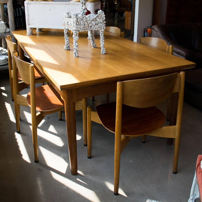 By influential Danish designer Jens Risom. Substantial and comfortable midcentury chairs with bentwood seats and backs. Dining height. Unique stacking chairs.