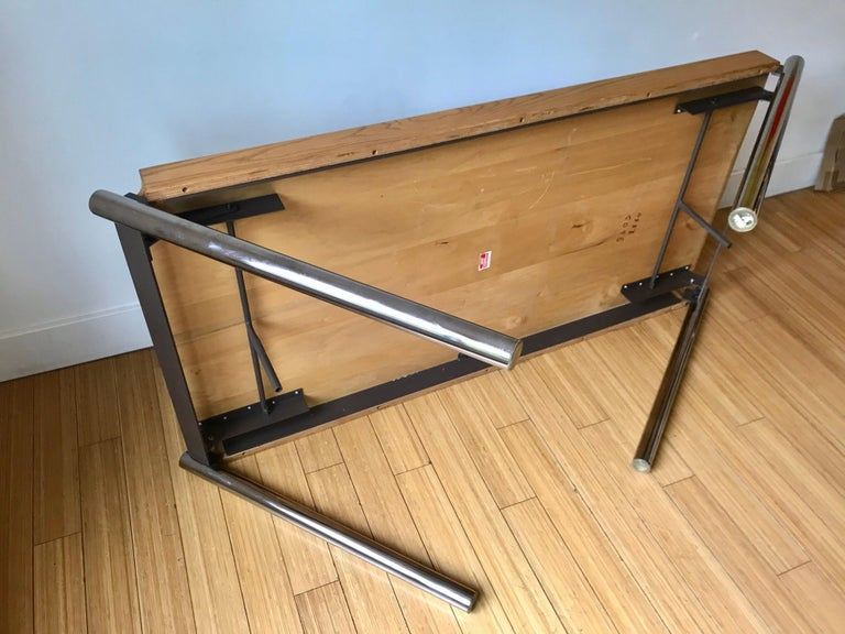 A handsome architectural design for Howe Furniture Corporation. Quality made of oakwood with chrome plated steel cylinder legs with enameled steel hardware / mechanics. Great for any occasion as a desk or for dining or entertaining.