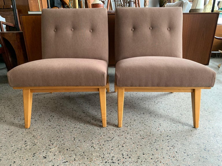 A great pair of early production Knoll, designed by Jens Risom, slipper chairs, circa 1950s with maple frames and early labels. Reupholstered in heavy cotton/denim fabric (85% cotton) by Spechler-Vogel Textiles, NYC.