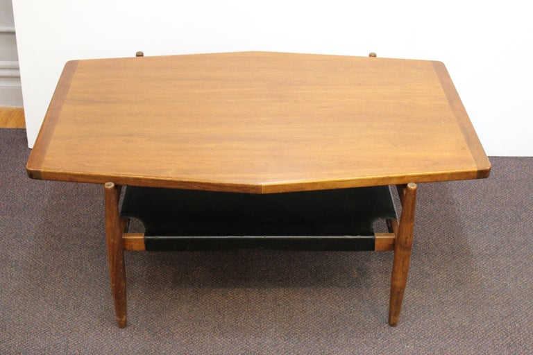 Mid-Century Modern coffee or cocktail table designed by Jens Risom in walnut and leather during the 1960s. The piece has a lower level in leather and is in great vintage condition, with some age-appropriate wear to the leather.