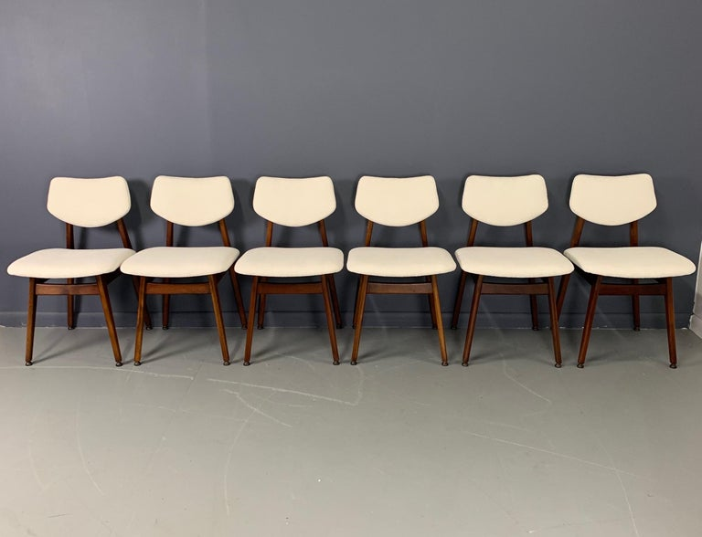 Set of six model C276 dining chairs in walnut by Jens Risom. Newly refinished and reupholstered in a lovely white textured velvet.