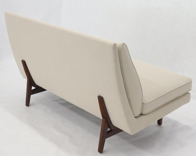 Mid-Century Modern Jens Rrisom sofa on oiled walnut legs.