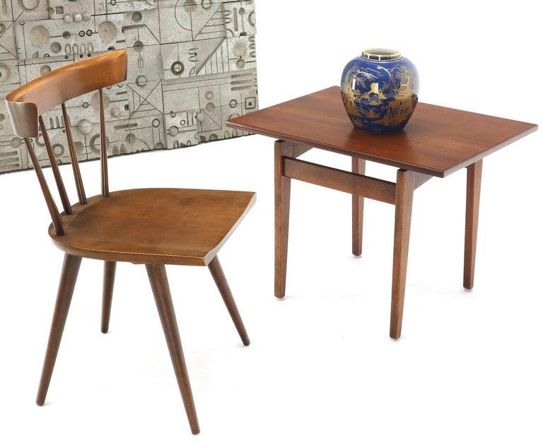 Mid-Century Modern oiled walnut side table by Jens Risom. Tapered solid walnut legs construction. Oiled walnut finish.