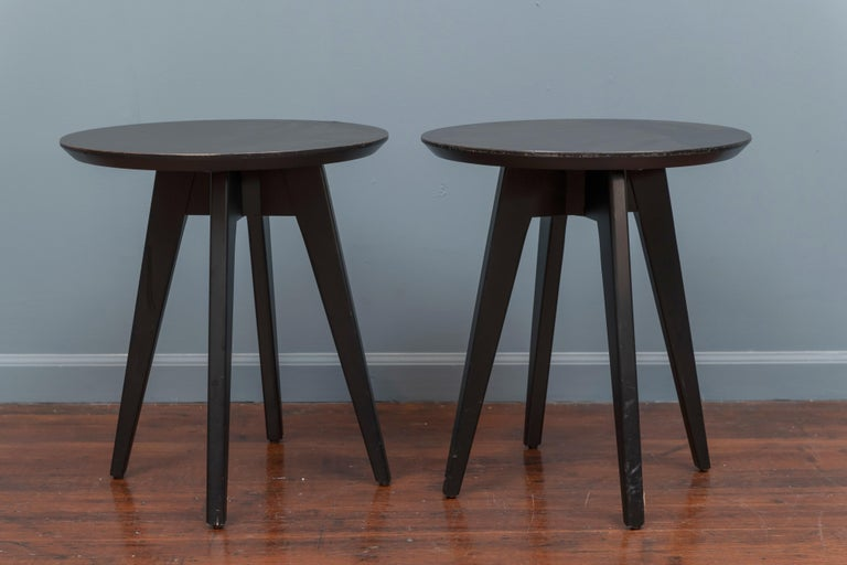 Jens Risom design pair of black lacquered side tables with black laminate tops for Knoll.  In good used condition with one small repaired chip seen in picture 4.