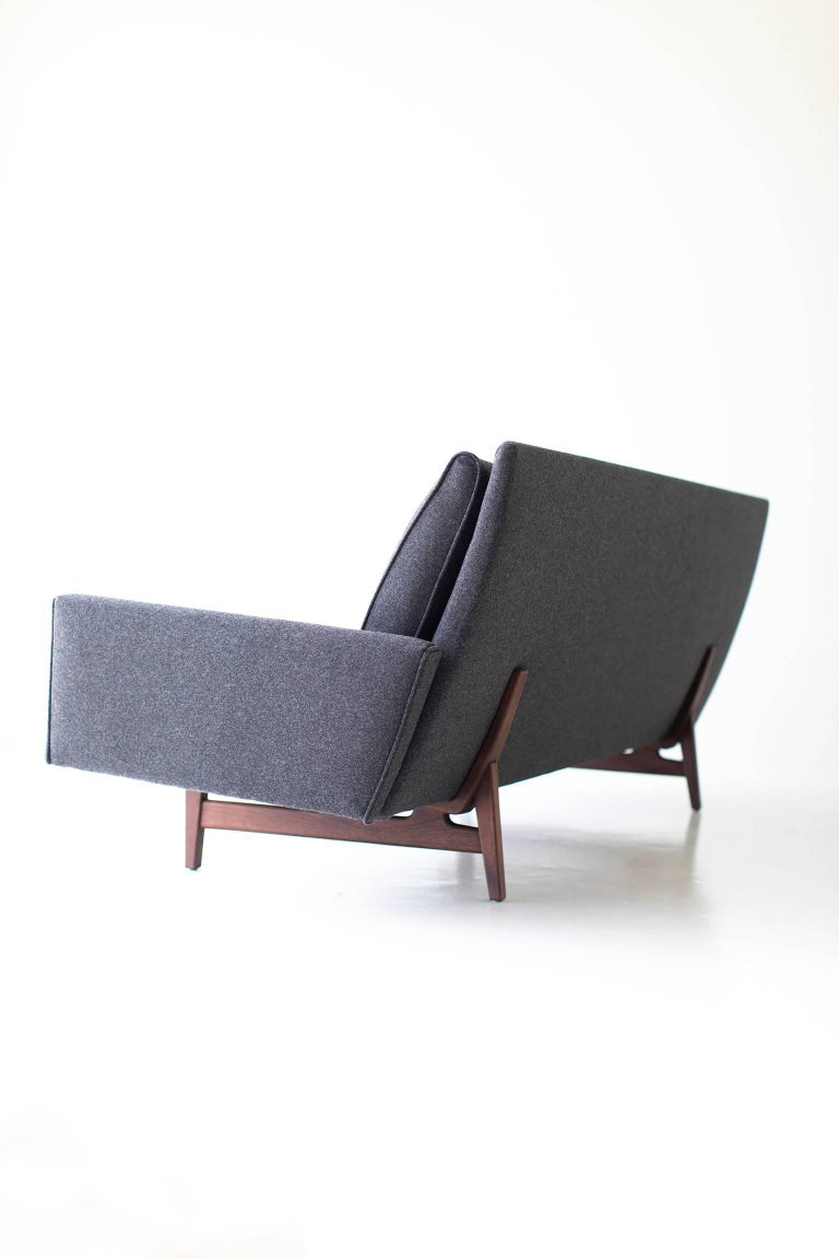 Designer: Jens Risom.   Manufacturer: Risom Design Inc.  Period or model: Mid-Century Modern.  Specs: Wool, walnut.   Condition:   This Jens Risom sofa for Risom Design Inc. is in excellent condition. The solid walnut frame has been oiled