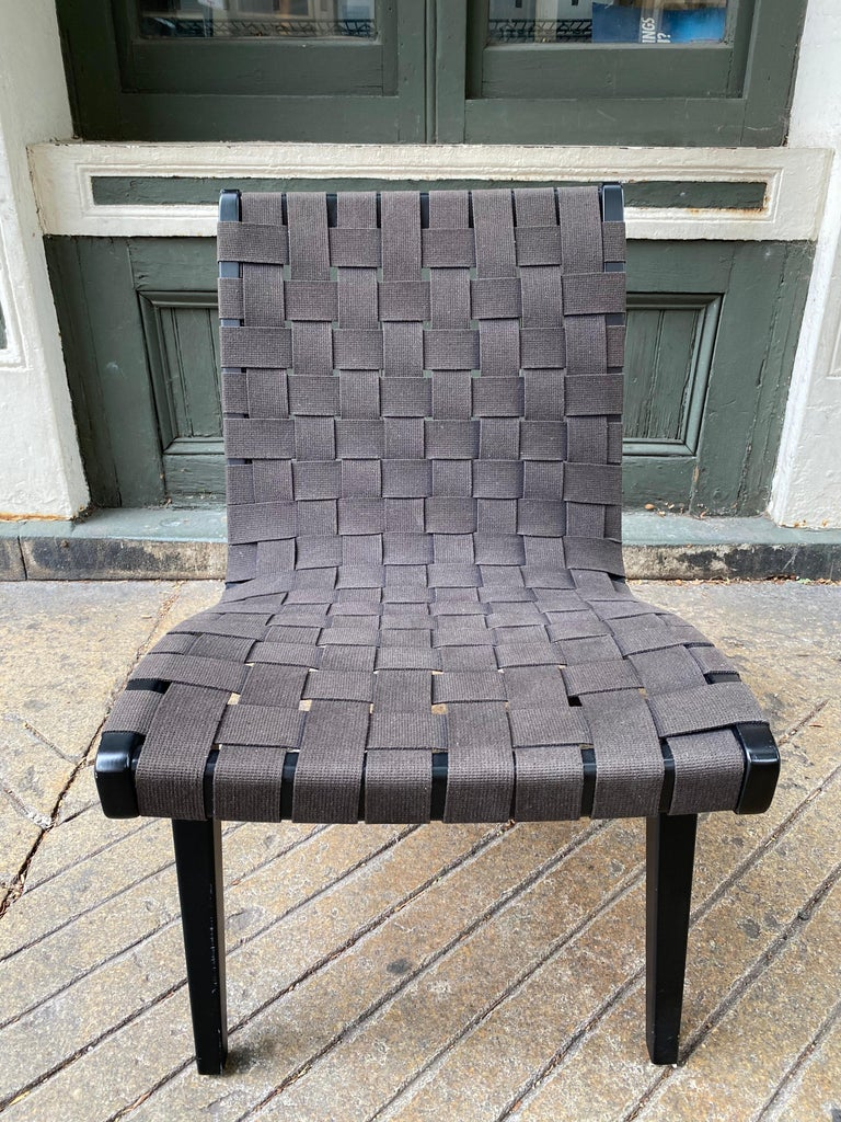 Jens Risom reintroduced webbed lounge chair. This chair is about 20 years old. Black webbing and black wood frame. Overall a pretty clean example of a Classic Early Risom for Knoll Design.