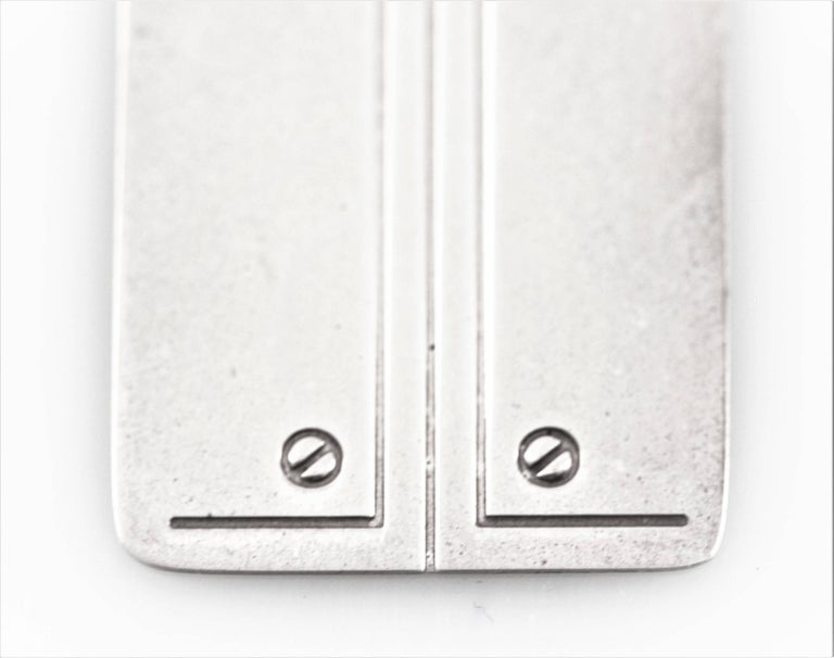 Every ask your self what to get the person who seems to have everything? Here's a great idea: a sterling bookmark. Super modern with a Jensen-esque feel, rounded on one end and straight on the other. Two screw-like designs on each side on the