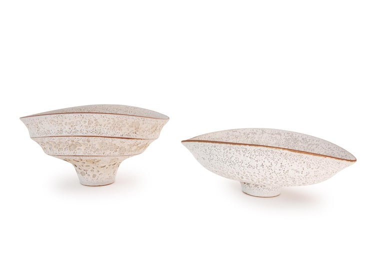 Double-tiered ceramic stemmed large bowl created in a mid-century modern style with a distinctive crackled volanic-like white textured finish by contemporary Arizona artist Jeremy Briddell. Please see Red Modern Furniture's other listings for more