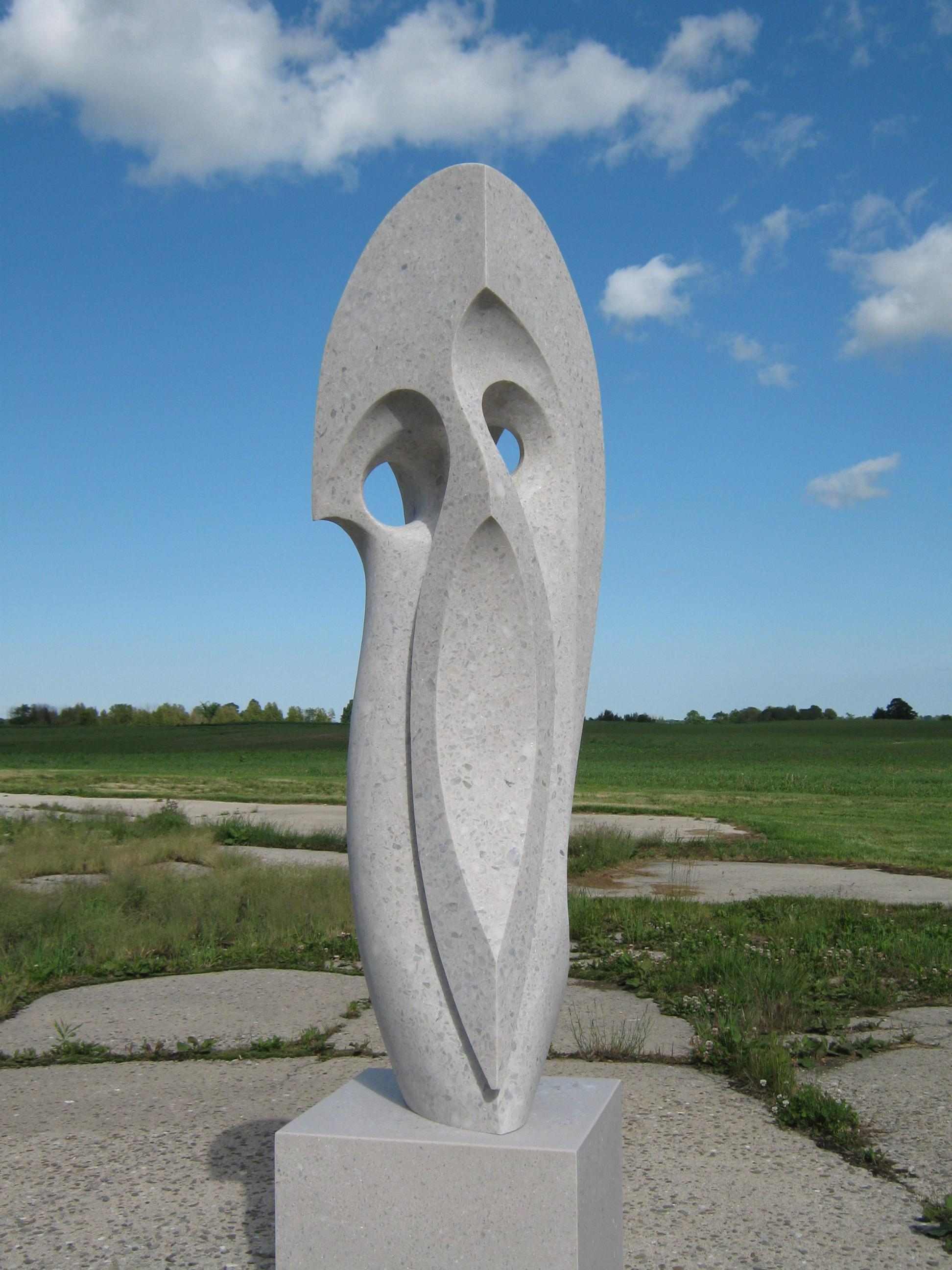 Curved Space - A tall white outdoor sculpture with flowing lines and curves