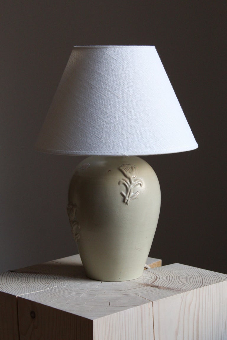 A table lamp designed by Jerk Werkmäster. Produced by Nittsjö, Sweden, 1950s. Stamped. With brand new high end lampshade.  Other designers of the period include Axel Salto, Paavo Tynell, Lisa Johansson-Pape, Carl-Harry Stålhane, and Gunnar Nylund.