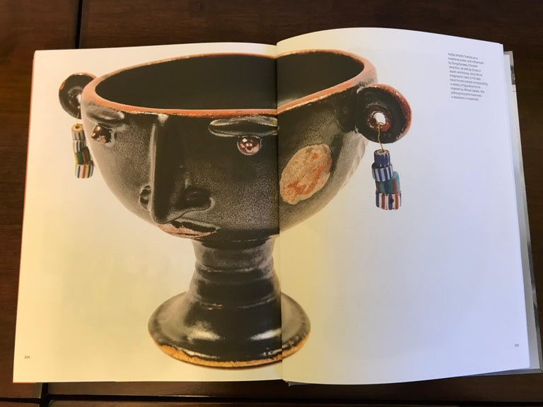 From the estate of the late Jerome and Evelyn Ackerman. A whimsical chalice design. It appears that he made only two or more of these. This one and the one pictured in the book. Wheel thrown pottery with handcrafted embellishments and mat black