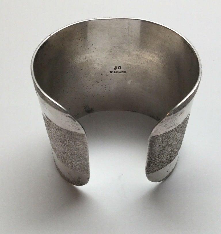 Jesse Claw Navajo sterling silver textured Aztec design cuff bracelet.  Marked: JC Sterling  Measures: 5 1/2