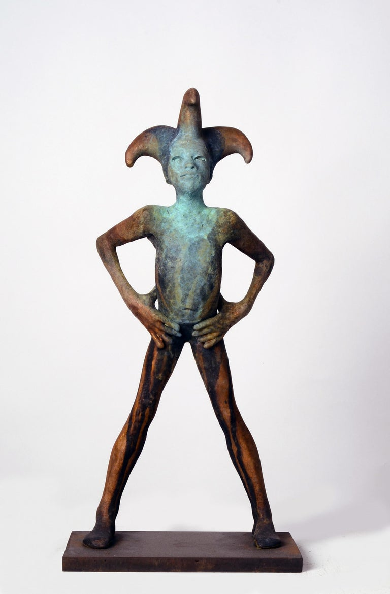 This small bronze by Jesus Curia depicts a harlequin with its three-pointed jester's cap stands defiantly with with belly pushed out and hands on hips.  The hand applied patina adds to the uniqueness of the sculpture.  The figure stands upon a steel
