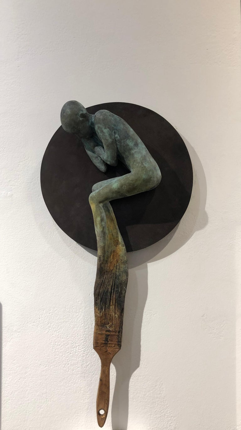 This is a surreal bronze sculpture of a sleeping figure being painted into existence.  It is cast in bronze and patinated with green verdigris and brown rust tones.    Jesús Curiá Perez Dream III, 2018 bronze and steel 20h x 10.50w x 3.50d in 50.80h