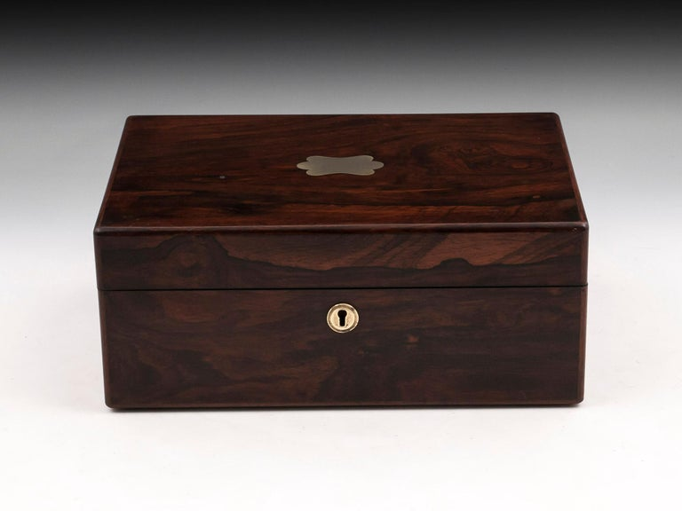 Antique Jewelry Box veneered in beautiful figured mahogany with brass escutcheon and vacant initial plate.  The interior is lined in vibrant red velvet and silk paper. It contains a removable jewelry tray with seven padded compartments of which two