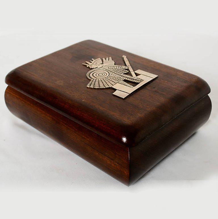 For your consideration a vintage jewelry box, hand-carved with exotic mahogany wood. Lid has an emblem of an Aztec warrior made in silver.  Unmarked, no information on the maker. No stamps.   The wood has been carefully polished with a smooth
