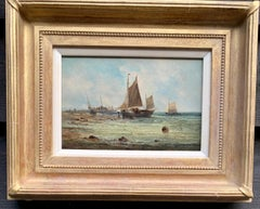 19th century antique English fishing boats by the shoreside