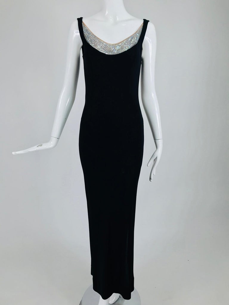 Jiki Monte-Carlo black backless nude rhinestone crystal gown. This amazing dress is fitted through the torso and hips, with deep side hem vents that reach the knees. Sleeveless, princess seamed dress with a low front neckline that has a band of nude