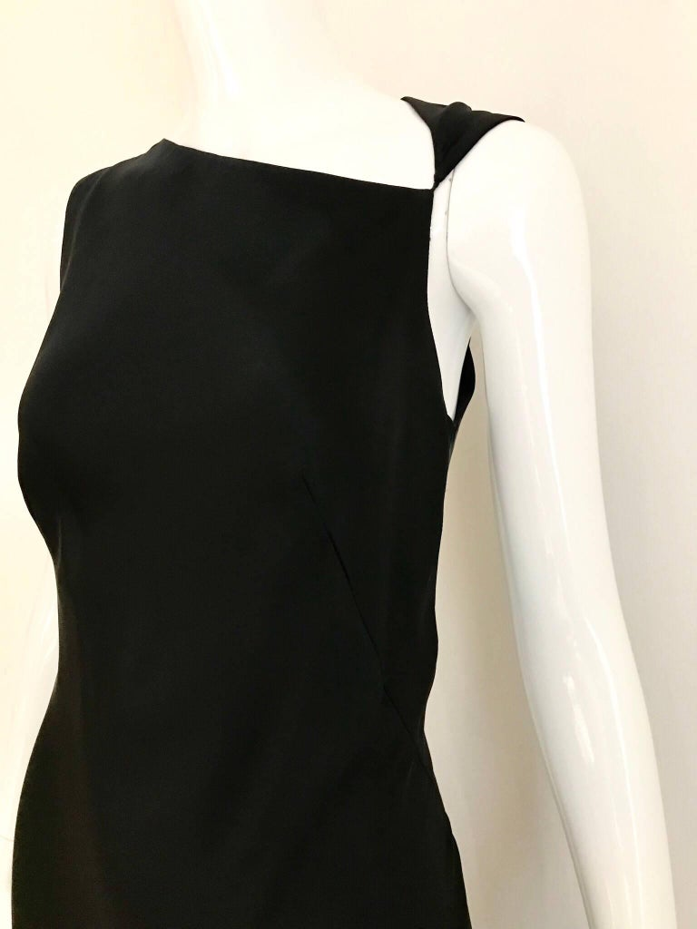 Classic and sexy Jil Sander black silk charmeuse sleeveless bias cut gown with asymetrical neckline. Fit size Small- Medium