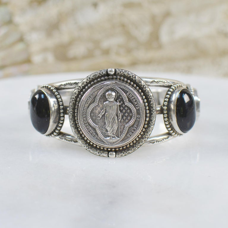 This one of a kind sterling silver Jill Garber cuff bracelet features a fine original antique nineteenth century French Sacred Heart Medal by engraver  Ludovic Penin, depicting the Christ child. Ludovic Penin 1830 - 1868, French master engraver was