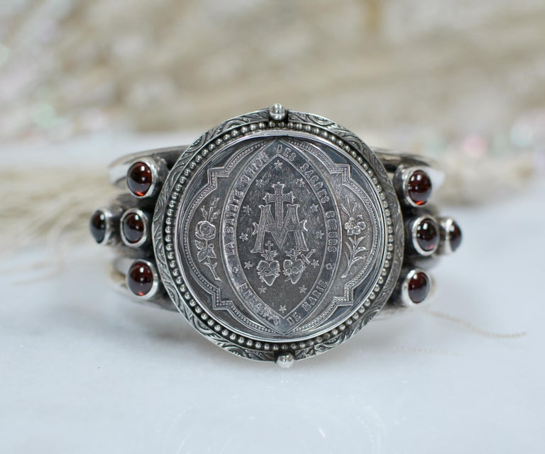 This one of a kind sterling silver Jill Garber cuff bracelet features a fine original antique nineteenth century French Sacred Heart Medal by engraver Ludovic Penin (1830 - 1868). The French master engraver was accorded the title